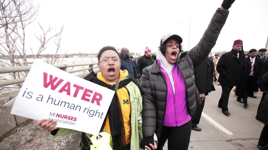 People participate in a national mile-long march in February to highlight the push for clean water in Flint, Mich.